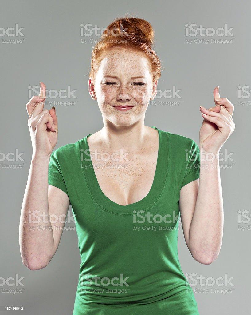 Teen Girl Crossing Fingers stock photo
