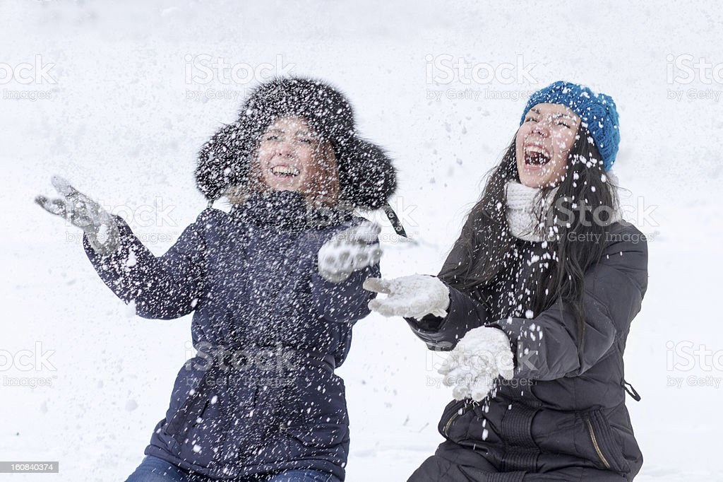 Teen girl friends outdoors in winter royalty-free stock photo