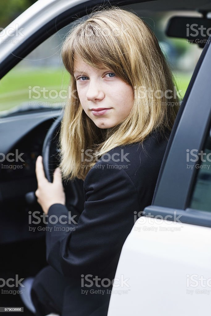Teen girl in a car royalty-free stock photo
