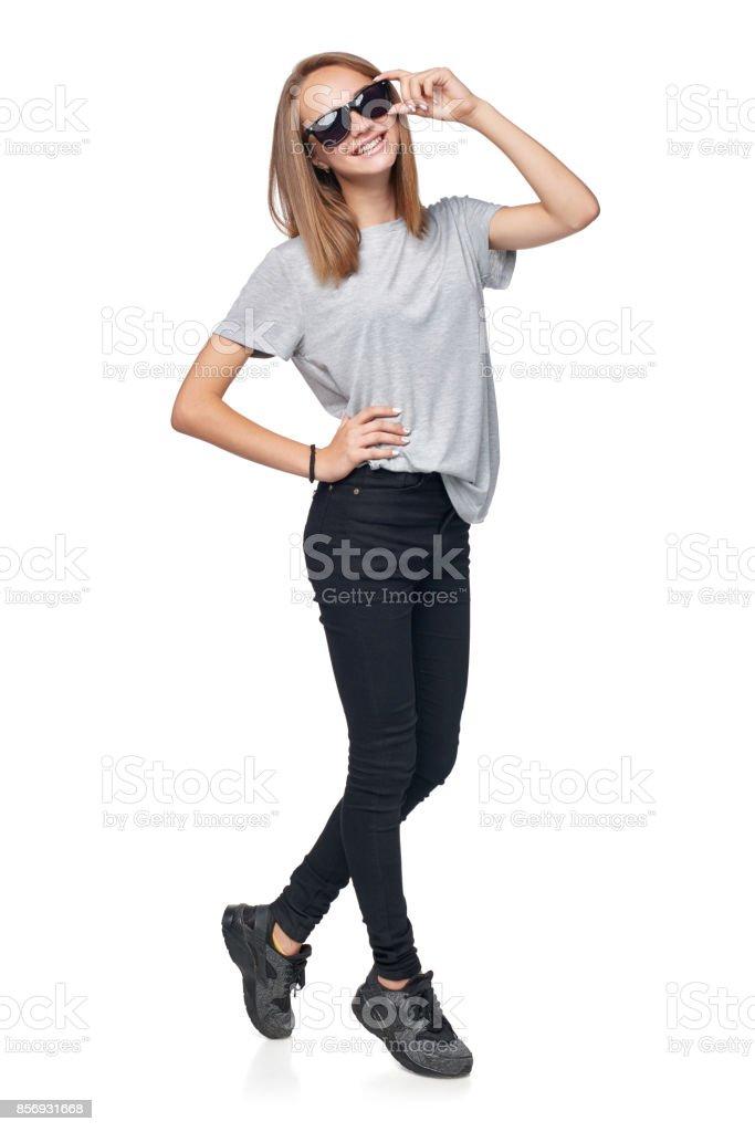 Teen girl in full length standing in sunglasses stock photo