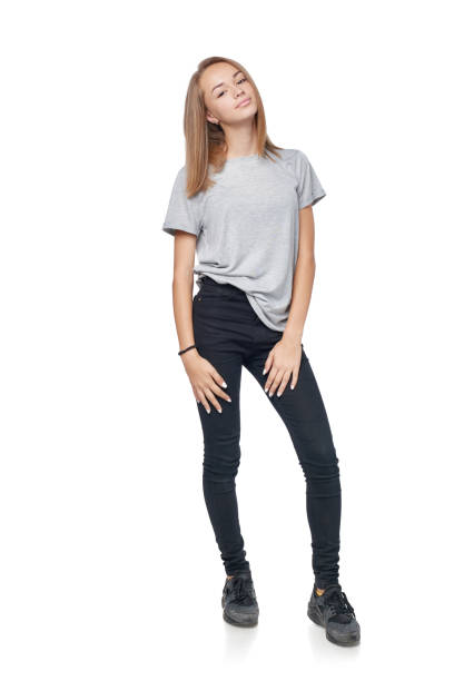 Teen girl in full length standing Teen girl in full length standing posing, isolated on white background skinny jeans stock pictures, royalty-free photos & images