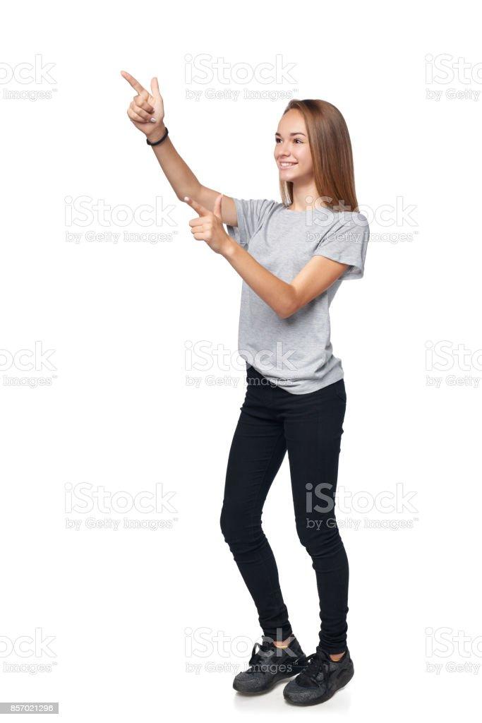 Teen girl in full length standing stock photo