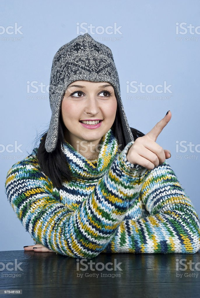Teen girl in winter clothes pointing royalty-free stock photo