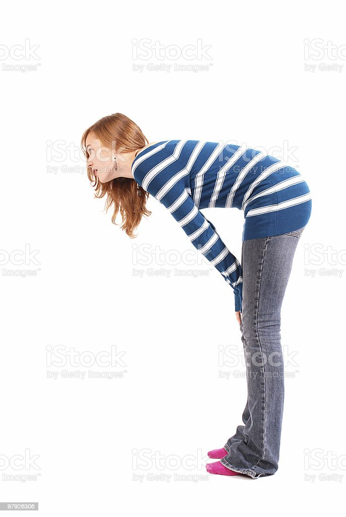 Teen girl leaning forward, profile view royalty-free stock photo