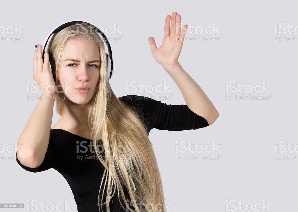 Teen Girl Listening to Music on Headphones Isolated  White Background stock photo