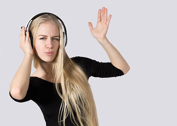 teen girl listening to music on headphones isolated  white background - young singles stock photos and pictures