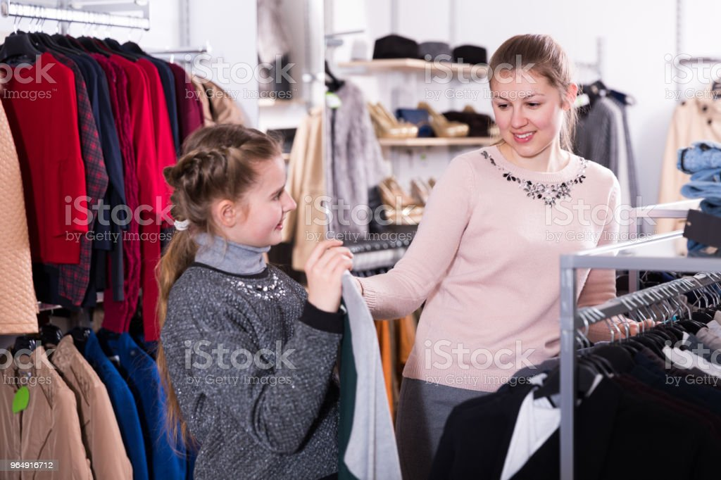 Teen girl looking for clothing with mum royalty-free stock photo