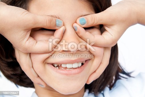 teen girl messing around making funny spectacles