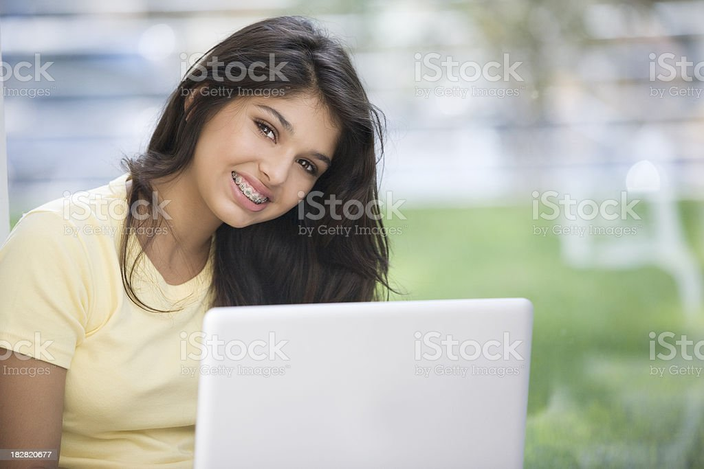 Teen Girl on Laptop stock photo