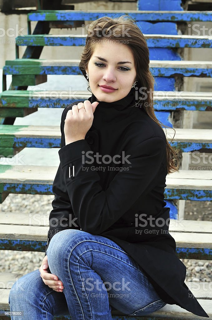 teen girl on the stairs royalty-free stock photo