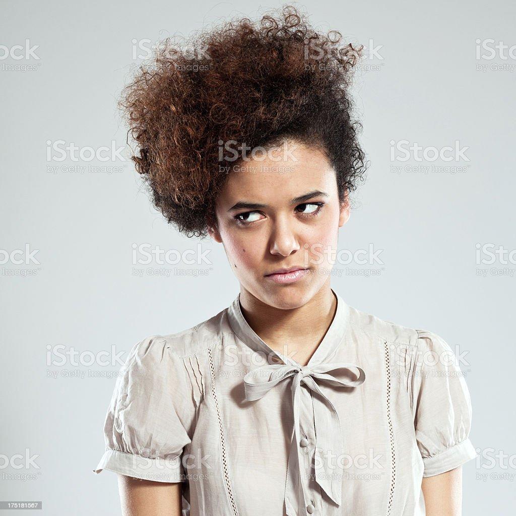 Teen Girl Portrait of serious teenaged afro girl looking away. Studio shot, grey background. 18-19 Years Stock Photo