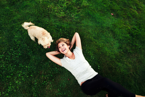 Teen Girl Playing with a Poodle