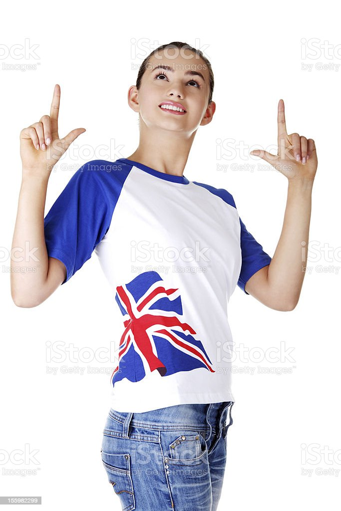 Teen girl pointing up on copy space. royalty-free stock photo