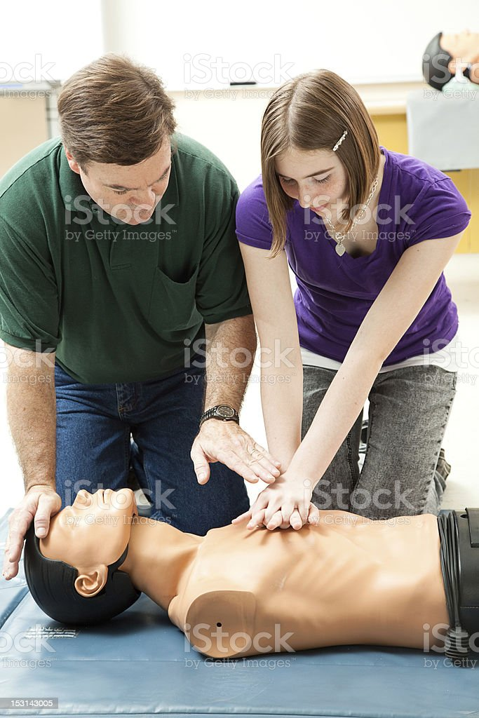 Teen Girl Practices CPR stock photo