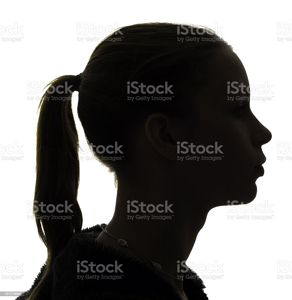 Teen girl silouhette stock photo