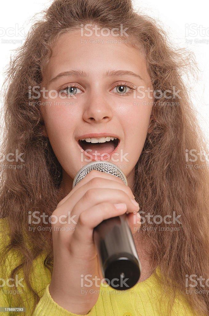 teen girl singing stock photo