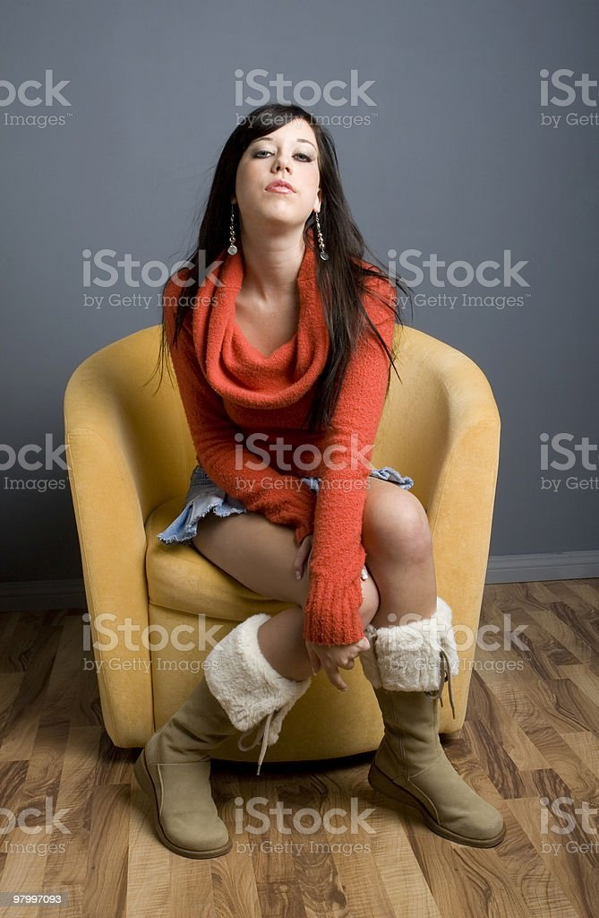 Teen girl sitting in chair royalty free stockfoto