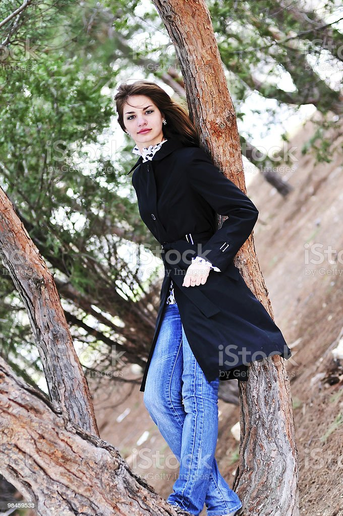 teen girl standing near the tree royalty-free stock photo