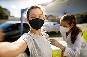 istock Teen girl taking a selfie while taking vaccine 1311551813