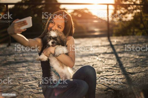 Teen girl taking selfie with puppy picture id855634846?b=1&k=6&m=855634846&s=612x612&h=kw3ffxkqedppt 8rdhc4p nxmtivfzl3b8i4dt7jwpg=