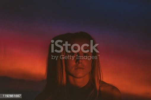 Photo of a teenage girl illuminated with neon lights