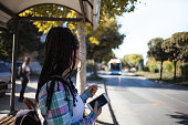 Close up of Teen girl waiting bus at the station