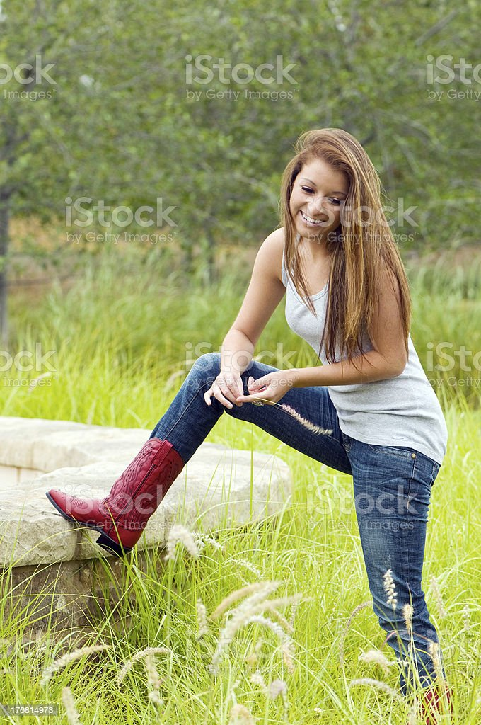 Teen Girl Wearing Jeans And Cowboy Boots Stock Photo More Pictures