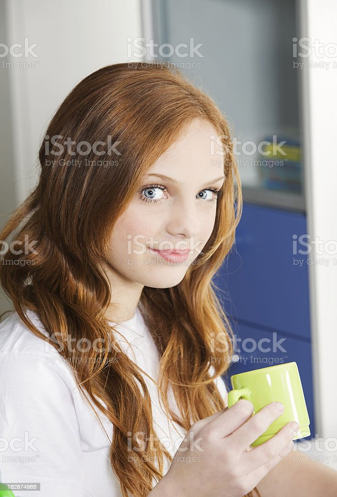 Teen Girl with a Cup of Coffee royalty-free stock photo