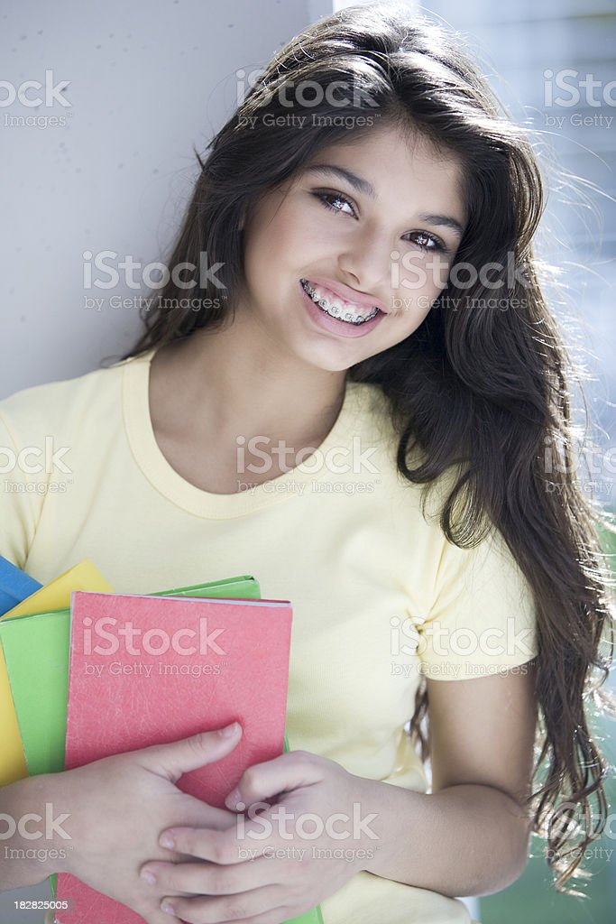 Teen Girl with Books stock photo