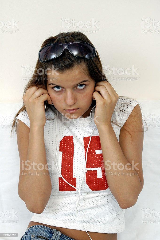 Teen Girl with Headphones stock photo