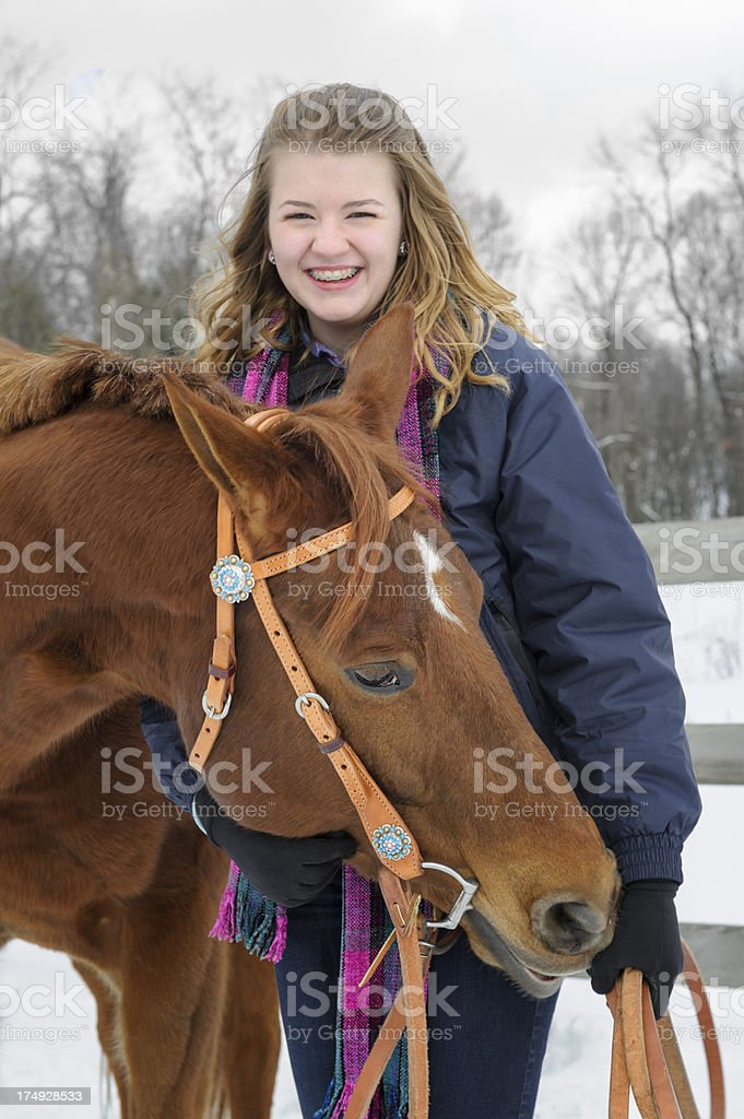 Teen Girl With Horse Nosing for Treats, Outdoors Winter Snow royalty-free stock photo