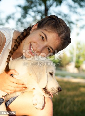 istock Teen girl with little puppy 860477160