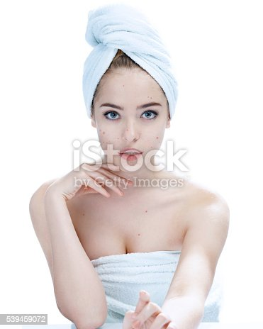514727472istockphoto Teen girl with problem skin. Woman skin care concept 539459072