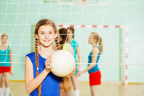 teen girl with volleyball ball in sports hall - volleyball stock photos and pictures