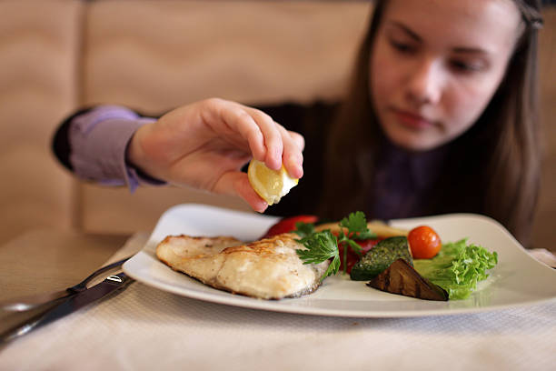 Teen has lunch stock photo