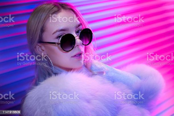 Teen hipster girl in stylish glasses and fur posing on street neon picture id1141918809?b=1&k=6&m=1141918809&s=612x612&h=bfcq0nklss2f4zv5 lswafxewglydq4pczqnxzztjx8=