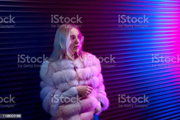 Teen hipster girl in stylish glasses and fur standing on purple neon picture id1138020166?b=1&k=6&m=1138020166&s=612x612&h=mdny4k wonnda2hat7i8tdnnjb0iu5q9hzue7ynzebm=