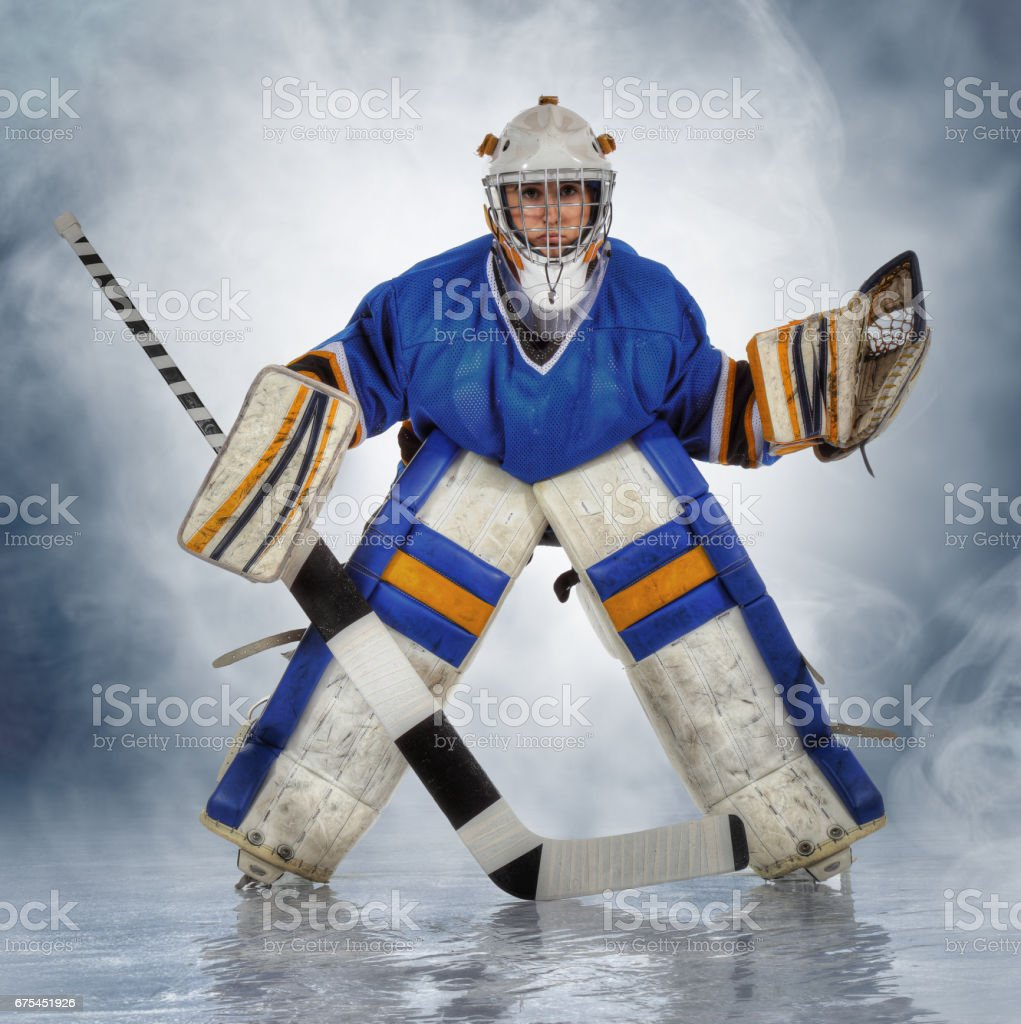 Teen Hockey Goalie In Blue Jersey Stock Photo Download Image Now