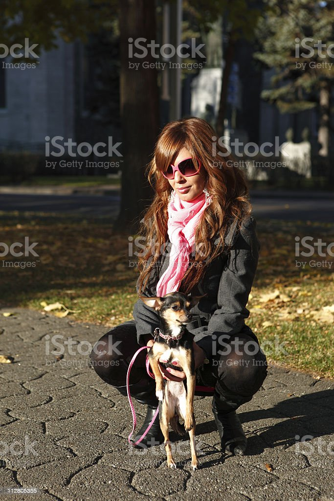 Teen hold her chiwawa stock photo