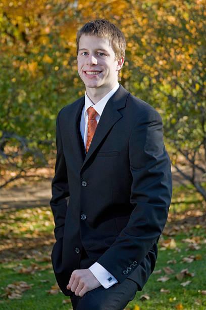 teen in suit stock photo