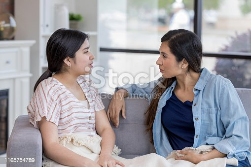 As the mid adult mom questions her, the teen girl becomes defensive.