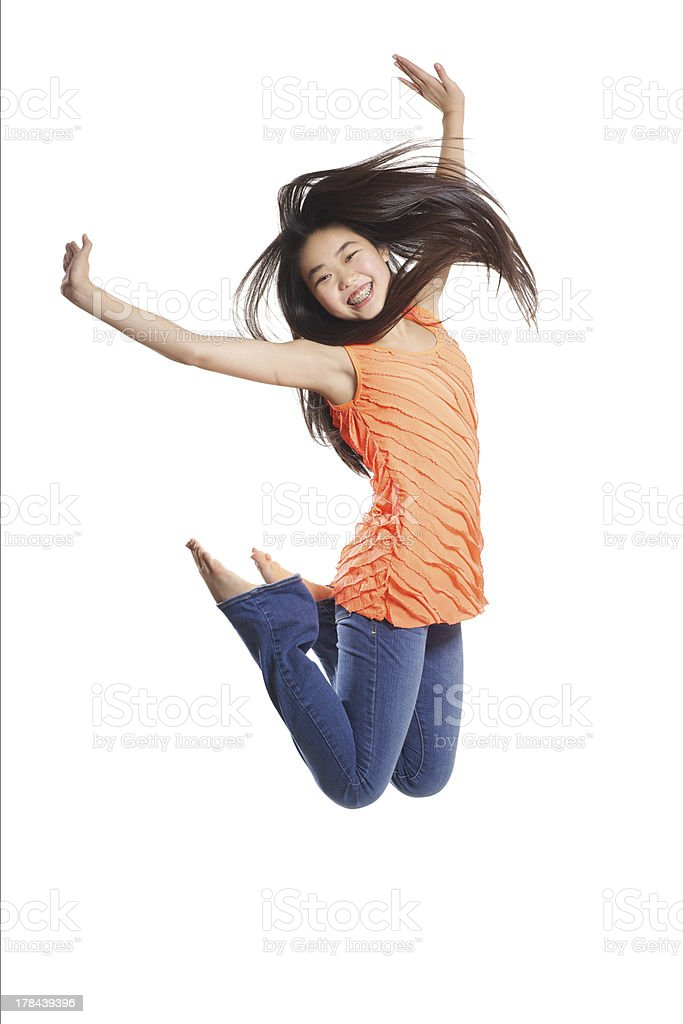 Teen Jumping Happily stock photo