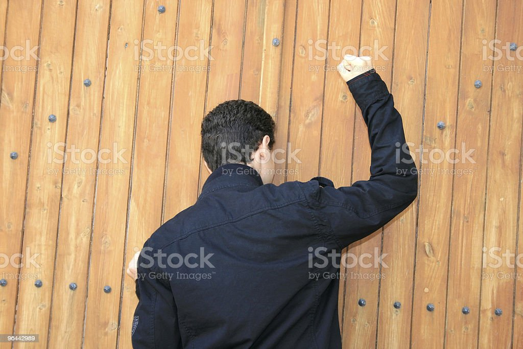 Teen knocking the door royalty-free stock photo