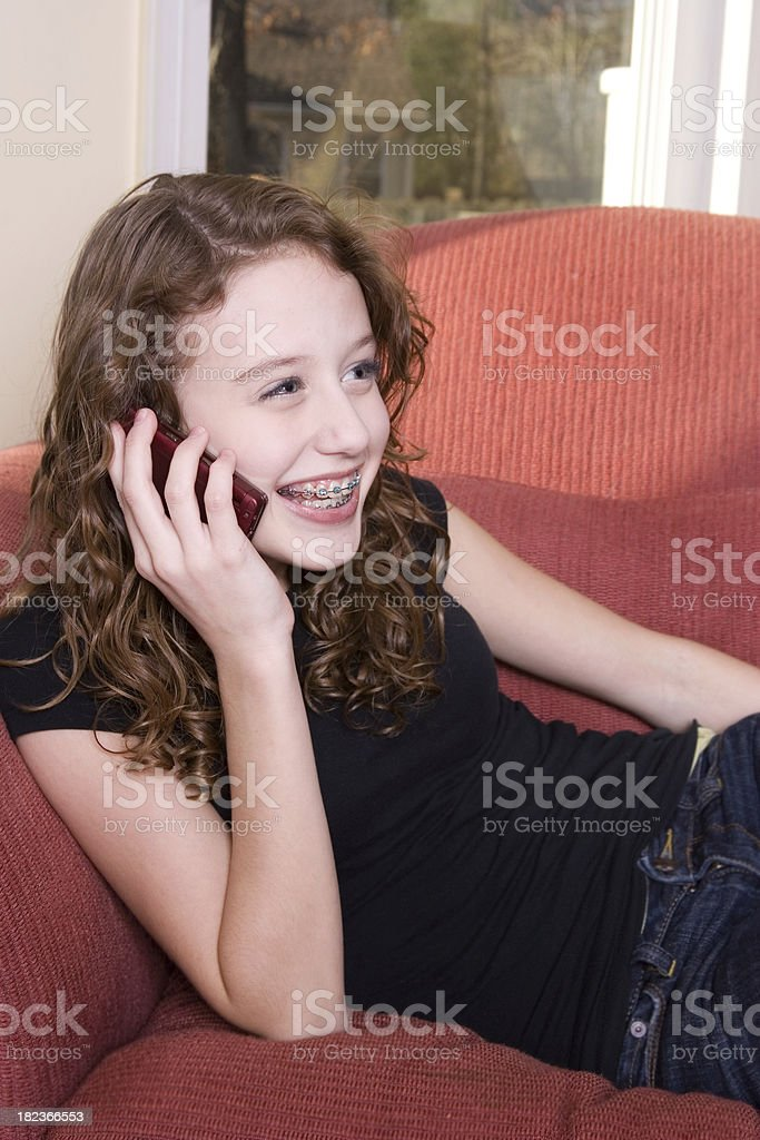 Teen laughs while on cell phone royalty-free stock photo