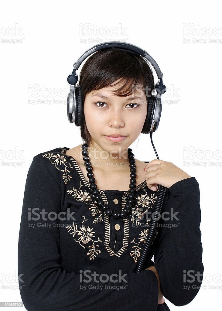 Teen listening to music royalty-free stock photo