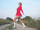 Bespectacled Blonde Teen Majorette Girl Outdoors in Red Dress
