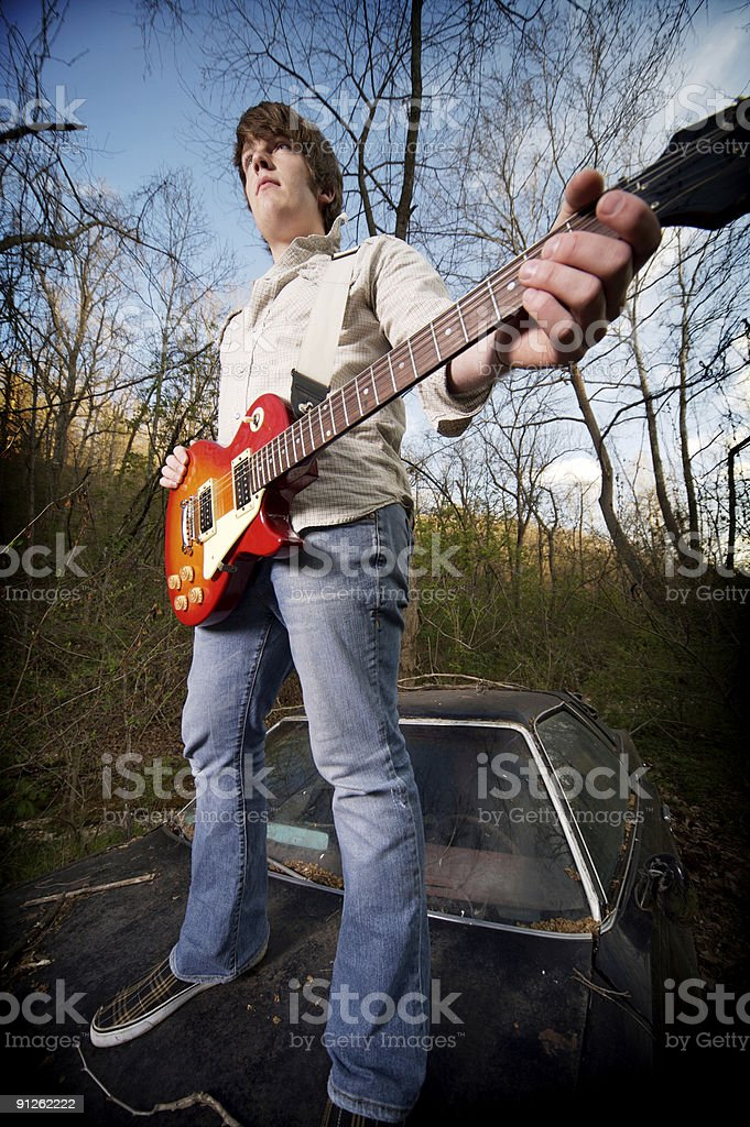 teen male musician outdoor portraits royalty-free stock photo