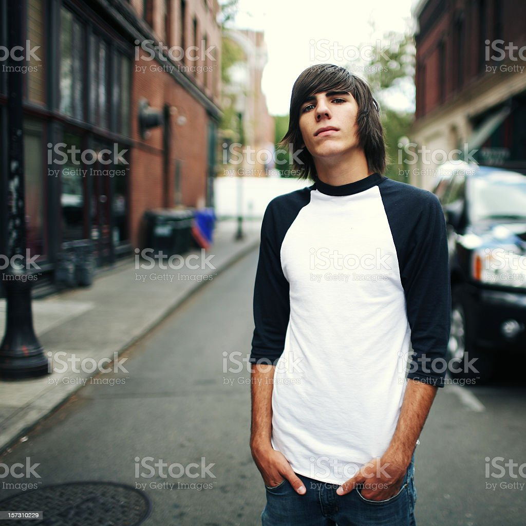 Teen Male Standing in a Small City Street royalty-free stock photo