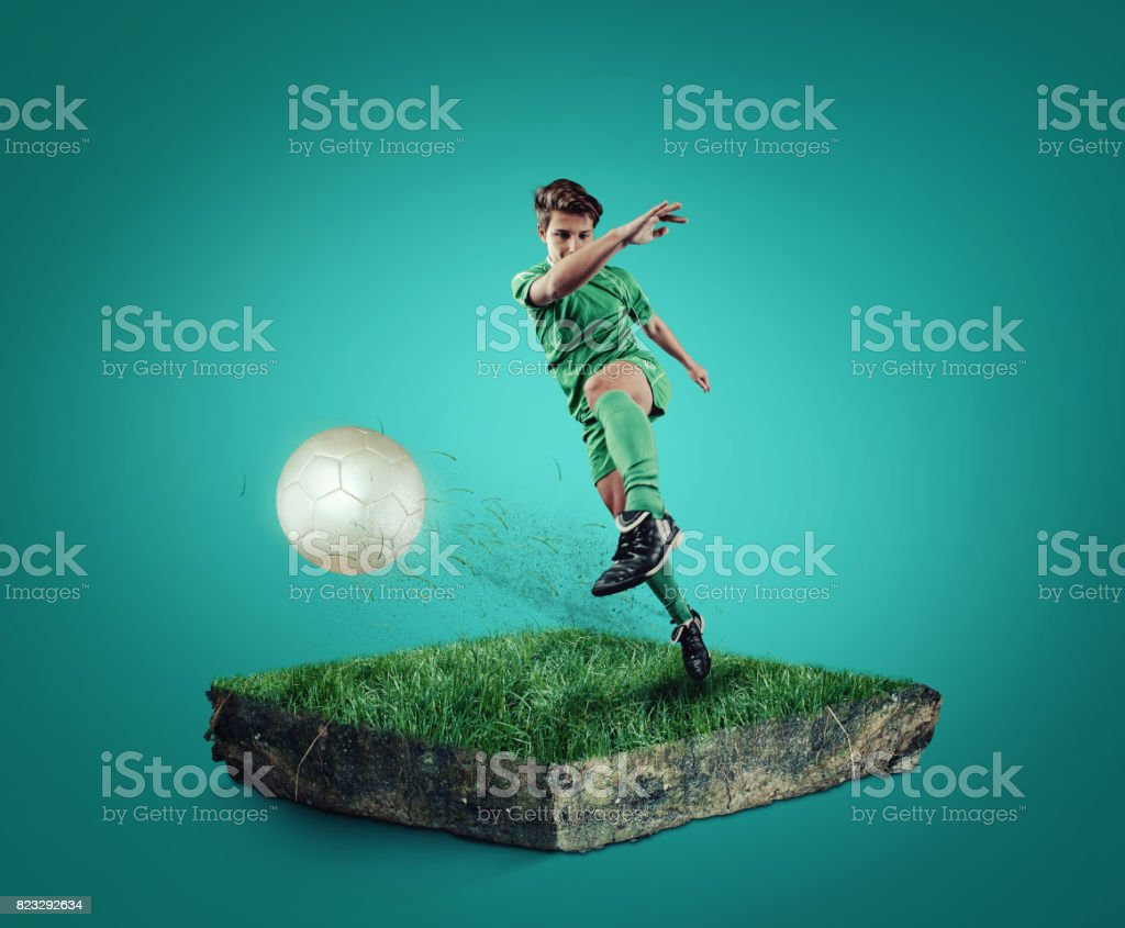 Teen playing soccer stock photo