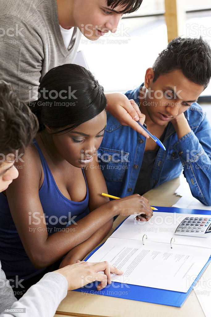 Teen pupils studying in school library royalty-free stock photo